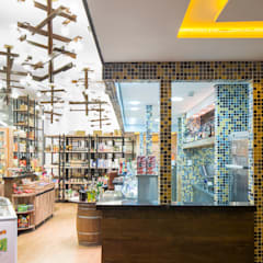 Offices & stores by Atmosfera Arquitetura Sociedade Ltda