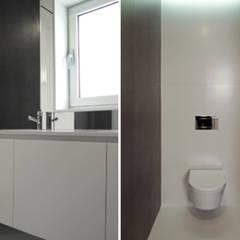 Apartamento em Trandeiras, Braga: Casas de banho  por ASVS Arquitectos Associados