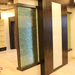 Residential Appartment @ Phoenix Market city - Chennai:  Corridor & hallway by ECUBE INTERIOR SOLUTIONS PVT LTD