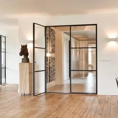 Sfeervol wonen:  Woonkamer door Jolanda Knook interieurvormgeving, Modern