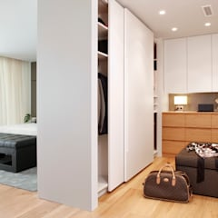 Walk in closet de estilo  por Molins Design