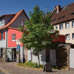 Umbau und Sanierung eines historischen Wohnhauses:  Ladenflächen von Hauptvogel & Schütt Planungsgruppe
