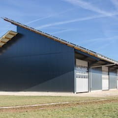 Maschinenhalle:  Garage & Schuppen von Hauptvogel & Schütt Planungsgruppe