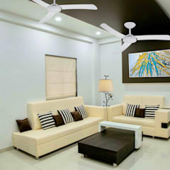 3 BHK Sample Flat:  Living room by ZEAL Arch Designs