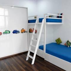 Mr.Reddy Residence:  Nursery/kid's room by Uber space