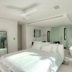Casa Oasis: Dormitorios de estilo  de MG&AG.ARQUITECTOS