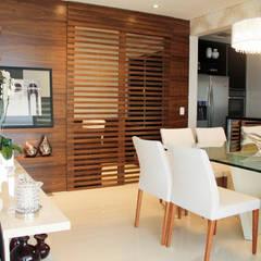 Apartamento Vila Clementino: Salas de jantar  por Sandro Kawamura Designer de Interiores