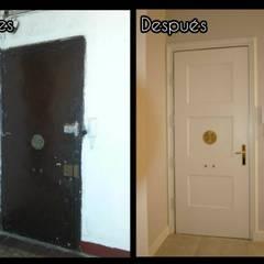 Antes y después de restauración de puerta de entrada: Ventanas de estilo  de FUSTERS CÓRDOBA