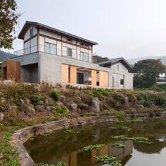 홍성주택: 위무위 건축사사무소의  주택