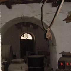 Intervento di consolidamento e restauro Palazzo Piccolo-Cupani a Ficarra in Piazza Monastero: Cantina in stile  di Ing. Edoardo Contrafatto