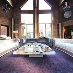 Log House:  Living room by Orkun İndere Interiors
