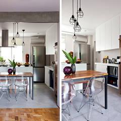 Apartamento da Cláudia e do Daniel Salas de jantar ecléticas por INÁ Arquitetura Eclético