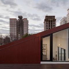 Minigimnasio: Gimnasios de estilo industrial por Paschetta&Cavallero Arquitectos