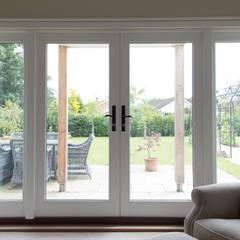 Sitting room:  Windows  by The Wood Window Alliance