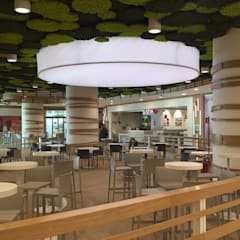 C.C. Auchan - Food Court: Centri commerciali in stile  di Principioattivo Architecture Group Srl