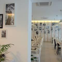 RISTORANTE + PESCHERIA: Gastronomia in stile  di luca troiani architetto