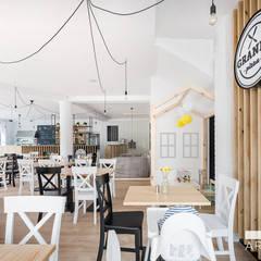 Wnętrza restauracji Grande Pizza:  Bars & Clubs von KRES Architekci