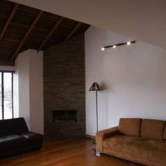 Sala de estar: Estudios y despachos de estilo  por Vowen