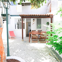 Projecto Apartamento Turístico T2 na Graça em Lisboa Varandas, marquises e terraços modernos por EU INTERIORES Moderno