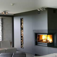 Recuperadores Lenha Bodart&Gonay - In Fire (com ventilação incorporada): Salas de estar  por Biojaq - Comércio e Distribuição de Recuperadores de Calor Lda,Moderno