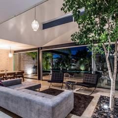 La Casa K27: Salas de estilo  por P11 ARQUITECTOS