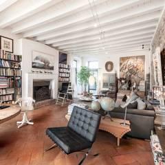 Salas / recibidores de estilo  por Studio Maggiore Architettura