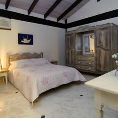 Phòng ngủ by Mellani Fotografias