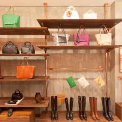 Nora Lozza - Andino: Espacios comerciales de estilo  por ODA - Oficina de Diseño y Arquitectura