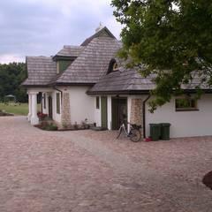 Widok na ogród od strony wjazdu na posesje.: styl , w kategorii Ogród zaprojektowany przez BioArt Ogrody, Architektura Krajobrazu
