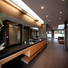Casa Galeana: Baños de estilo  por grupoarquitectura