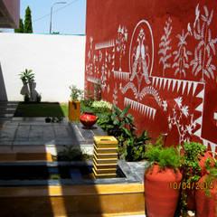 Jardines de estilo  por ar.dhananjay pund architects & designers ,