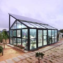 썬룸에서 즐기는 따뜻한 햇살 [서산 부산리]: 윤성하우징의  주택