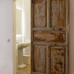 Wooden doors by The Sibarist Property & Homes