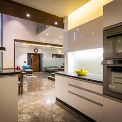 Chandresh bhai interiors:  Kitchen by Vipul Patel Architects