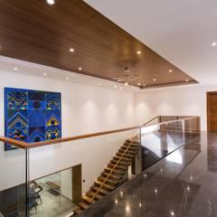 Jayesh bhai interiors:  Corridor & hallway by Vipul Patel Architects