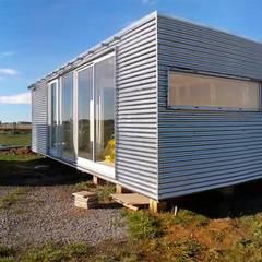 Maisons de style  par riverorolnyarquitectos, Industriel