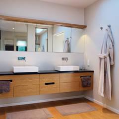 Bathroom:  Bathroom by Baufritz (UK) Ltd.