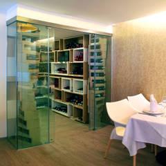 Restaurante El puntal : Comedores de estilo  por DIN Interiorismo ,