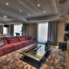 Living: Salas de estar  por Pauline Kubiak Arquitetura