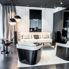 Część wypoczynkowa / salon: styl , w kategorii Centra wystawowe zaprojektowany przez Intelidom Group Sp. z o.o.
