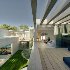 The Wall House: Terraços  por guedes cruz arquitectos