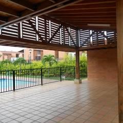 ZONA SOCIAL CR ENTRE PARQUES CLUB : Salas de estilo  por ARQUITECTONI-K Diseño + Construcción SAS