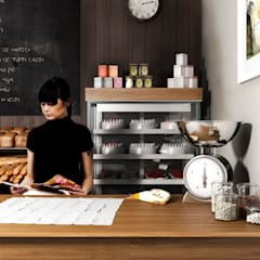 Panadería en San Martín de los Andes Estudios y oficinas rústicas de AQ Rendering Rústico