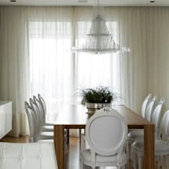 Dining room by DIEGO REVOLLO ARQUITETURA S/S LTDA., Modern