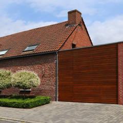 Garage avec vue: Garage / Hangar de style de style Moderne par VORTEX atelier d'architecture