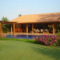 Casa Sol : Casas de estilo  por José Vigil Arquitectos , Tropical
