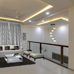 First Floor Lounge:  Living room by KREATIVE HOUSE