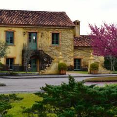Condomínio Reserva da Serra: Jardins  por creare paisagismo