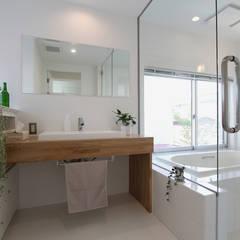 東長町の家: 環境建築計画が手掛けた浴室です。