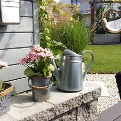 donice ogrodowe: styl , w kategorii Ogród zaprojektowany przez Ogrodowa Sceneria